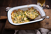 Potato and courgette gratin with cashew cream and vegan cheese substitute