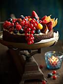 Dark chocolate cake lavishly decorated with icing and fruits