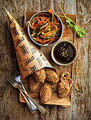 Oriental croquettes with sesame seeds