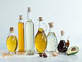 Various oils in bottles on a light background