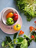 Nasturtium, colourful tomatoes and frisee salad