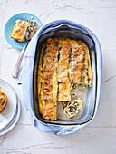Chard strudel with sultanas, egg-milk glaze and grainy cream cheese