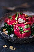 Beetroot tortellini with goat's cheese truffle filling and palm kale