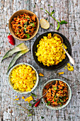 Chilli rice with garlic, coriander and black beans, saffron rice with pineapple and corn (Caribbean)