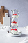 Jar tower with yoghurt and fresh raspberries
