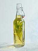 Sage oil in a flip-top bottle