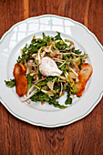 Dandelion salad with bacon, potatoes and egg from Baden