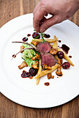 Saddle of venison with cherries, savoy cabbage and Schupfnudeln (potato orzo pasta) from Baden