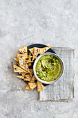 Pea, spring onion and black lime hummus with pitta chips