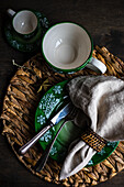 Holiday Christmas dinner place setting on wooden vintage table