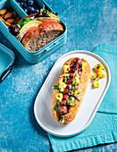 Hawaiian vegan hot dog, vegan sandwich with cold-cut slices