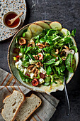 Lamb's lettuce with mushrooms, cherries, apple slices and feta cheese