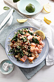 Quinoa with stewed spinach and baked salmon