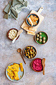Spread of Meze of Homemade Crackers, Grilled Olives, Labneh Balls, Beetroot Hummus and Moutabel