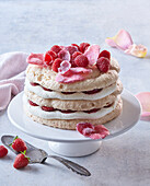 Meringue cake with candied rose petals
