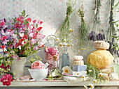 Still life with scented plants, scented oils and scented soaps