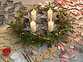 Christmas wreath with holly and spruce around it Christmas cookies