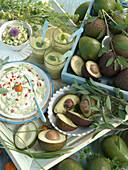 An avocado arrangement with avocados, avocado smoothie, avocado quark cream and spread