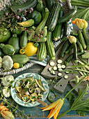 Different kinds of courgettes and plate with baked courgette slices