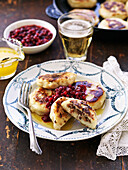 Potato dumpling with bacon and lingonberries