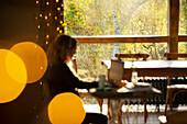 Businesswoman working in café