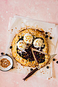 Blackberry Galette with Peanut Croquant, Decorated with Pearl Sugar, Served with Vanilla Ice Cream