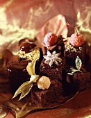 Fancy chocolate cakes decorated with candied fruit