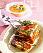 Fattened hen terrine with multicolored pepper and yellow pepper and orange juice gaspacho