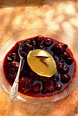 Warm summer fruit soup with vanilla ice cream