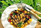 Thinly sliced veal,mango and mixed vegetable salad