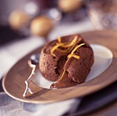 Chocolate sponge dessert with orange sorbet