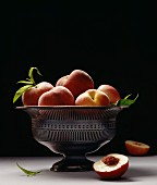 silver bowl of peaches