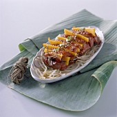 Fillets of duck breast with slivers of mango