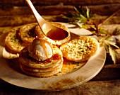 Scottish pancakes with vanilla ice cream and maple syrup