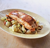Pan-fried salmon fillet with bourgignonne cabbage and bacon