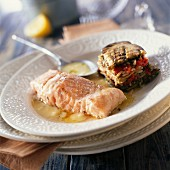 Roast salmon fillet with lemon sauce and eggplant mille-feuille