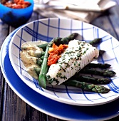 Sole gougeonnettes with dawn sauce asparagus and candied tomatoes