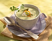 Creamed asparagus soup topped with cream