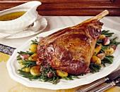 Leg of lamb with princess beans, potatoes and garlic