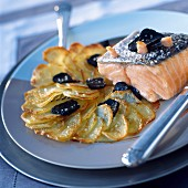 Grilled salmon with bacon, potato cake with truffles