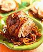Rolled pork with orange zest and preserved onions