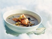 Mushroom consommé with langoustines