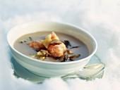 Mushroom consommé with langoustines