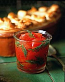Peeled tomatoes with dill