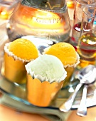 paper cups of sorbet with glass of grappa