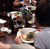 person eating convivial meal restaurant