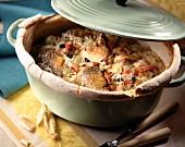 Guinea-fowl sauerkraut in a casserole dish sealed with bread dough