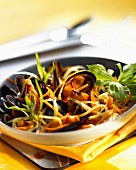 Mussels with saffron flavored baby vegetables