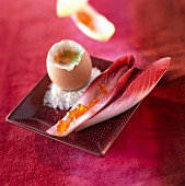 Boiled egg, chicory soldiers with salmon roe cream