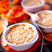 Individual pumpkin and tomato cheese-topped dish